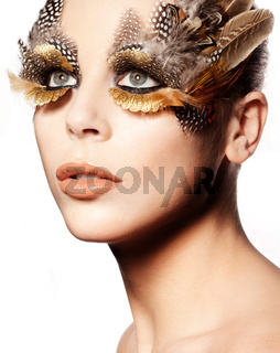 Woman with feather makeup