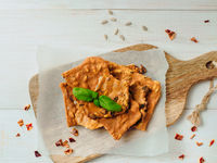 Gluten-free crispbreads on white wooden bg