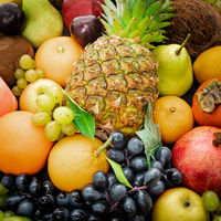 Various assorted juicy fruits. Fresh fruits colorful background.