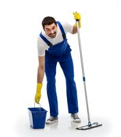 male cleaner cleaning floor with mop and bucket