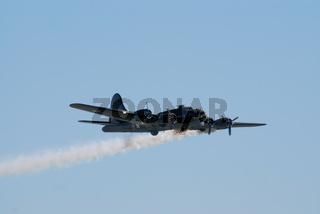Boeing B-17 flies with smoke trail