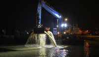 Dredger working at night
