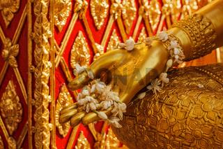 Buddha statue hand with flowers. Wat Phra That Doi Suthep