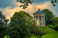 English Garden of Munich - The beautiful temple architecture of the Monopteros at the fall season with sunset clouds.