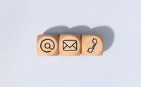 Contact us icons on wooden blocks isolated on gray background