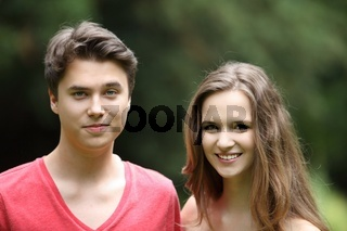 Smiling young teenage boy and girl