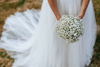 Closeup of hands of a bride holding her beautiful wedding bouquet