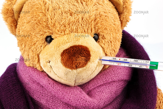 Teddy bear with fever thermometer