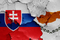 flags of Slovakia and Cyprus painted on cracked wall