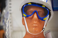 Close-up of the face of a plastic mannequin wearing goggles.