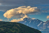 Lenticular cloud formation over volcano