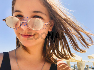 Smiling teenager on beach in summer