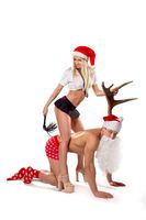 Sexy mistress and obedient man in Santa hat