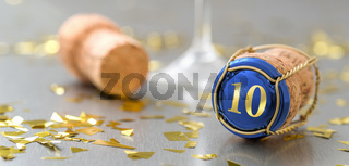 Champagne cap with the Number 10