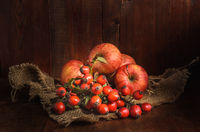 apples and other fruits on a dark wooden background in a rustic style