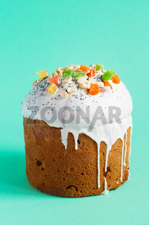 Easter Cake - Russian and Ukrainian Traditional Kulich on a bright turquoise blue background. Paska Easter Bread. Happy easter. Kulich cake symbol of Traditional Orthodox Easter