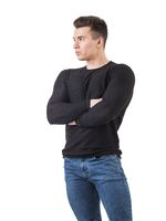 Handsome young man in black sweater standing, arms crossed on chest