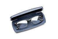 Modern spectacles, or eyeglasses, in a dark blue leather case
