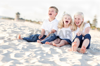 Cute Sibling Children Sitting at the Beach
