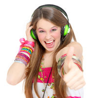 teen with headphones and thumbs up