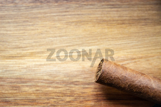 Brown cuban cigar on wooden background