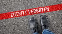 Red line on asphalt - Do not enter in german - Zutritt verboten