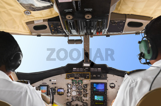 Pilots in the plane cockpit and sky