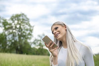 happy young woman with smartphone