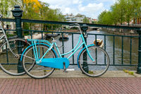 Amsterdam, canals and bikes. City travel concept.