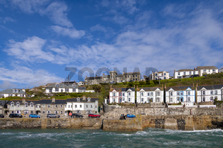 PORTHLEVEN, CORNWALL, UK - MAY 11 : View of the town and harbour in Porthleven, Cornwall on May 11, 2021. Three unidentified people