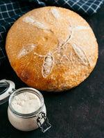 Wheat round sourdough bread, copy space, vertical