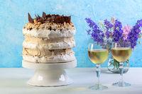 Meringue cake with cream, chocolate and hazelnuts.