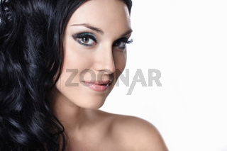 A beautiful young girl with makeup and hair on white background