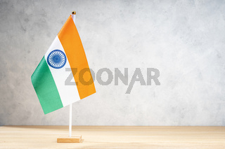 India table flag on white textured wall. Copy space for text, designs or drawings