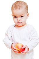 Baby girl with healthy food isolated