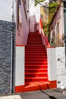 Narrow stairway with bright red painted treads in Santa Cruz de la Palma