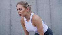 Exhausted female jogger taking break
