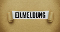 Torn paper revealing the words Breaking news in german - Eilmeldung