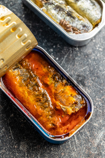 Canned sardines with tomato sauce. Sea fish in tin can.