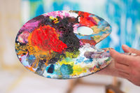 Painting therapy: Close up of artist holding color palette