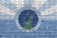 flag of Leelanau County, Michigan painted on brick wall