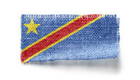Democratic Republic of the Congo flag on a piece of cloth on a white background