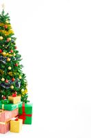 Composition of christmas tree with decorations, presents and copy space on white background