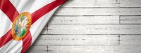 Florida flag on white wood wall banner, USA
