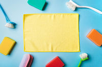 House cleaning product on blue background, copy space