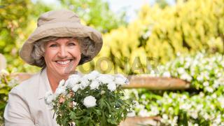 Smiling woman in her garden