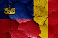 flags of Liechtenstein and Romania painted on cracked wall