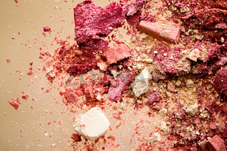 Crushed cosmetics, mineral organic eyeshadow, blush and cosmetic powder isolated on golden background, makeup and beauty banner, flatlay design