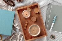 Hygge. Cozy winter morning. A cup of coffee with scented candles and a blanket