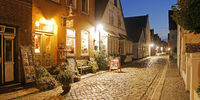Houses in the street Wasserzeile in the evening, in which Theodor Storm also lived, Husum, Germany